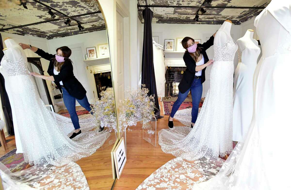 """Madison, Connecticut -Friday, May 1, 2020: Chelsea McNamara, owner of Everthine Bridal Boutique in Madison, a non-traditional """"fashion forward stylish bridal shop that encourages brides to """"step out of the box"""" when choosing their gowns. McNamara, using appointments, conducts virtual visits with brides using Zoom."""