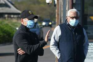 Greenwich First Selectman Fred Camillo, left, and Parks & Recreation Director Joe Siciliano wear masks as they hang out at the gate during the reopening of Greenwich Point Park in Old Greenwich, Conn. Thursday, May 7, 2020.
