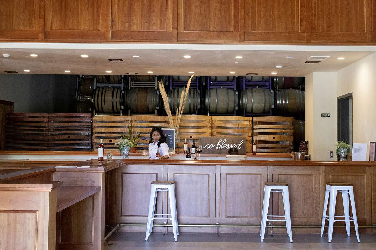 Miriam Puentes stands behind the empty bar at Honrama Cellars tasting room in Sonoma, Calif. Tuesday, May 5, 2020. Juan and Miriam Puentes own Honrama Cellars, and before the crisis they sold 100% of their wine through their tasting room. With their tasting room closed, they're worried about the future.