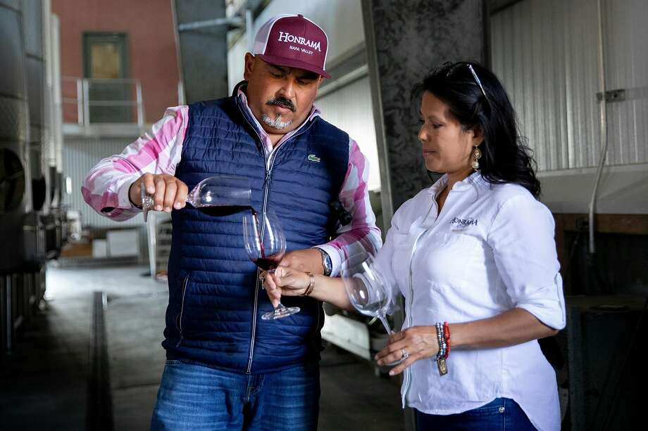 Juan Puentes pours a taste of Pinot noir straight from the tank for his wife Miriam while at Honrama Cellars tasting room in Sonoma, Calif. Tuesday, May 5, 2020. Juan and Miriam Puentes own Honrama Cellars, and before the crisis they sold 100% of their wine through their tasting room. With their tasting room closed, they're worried about the future. Photo: Jessica Christian / The Chronicle 2020