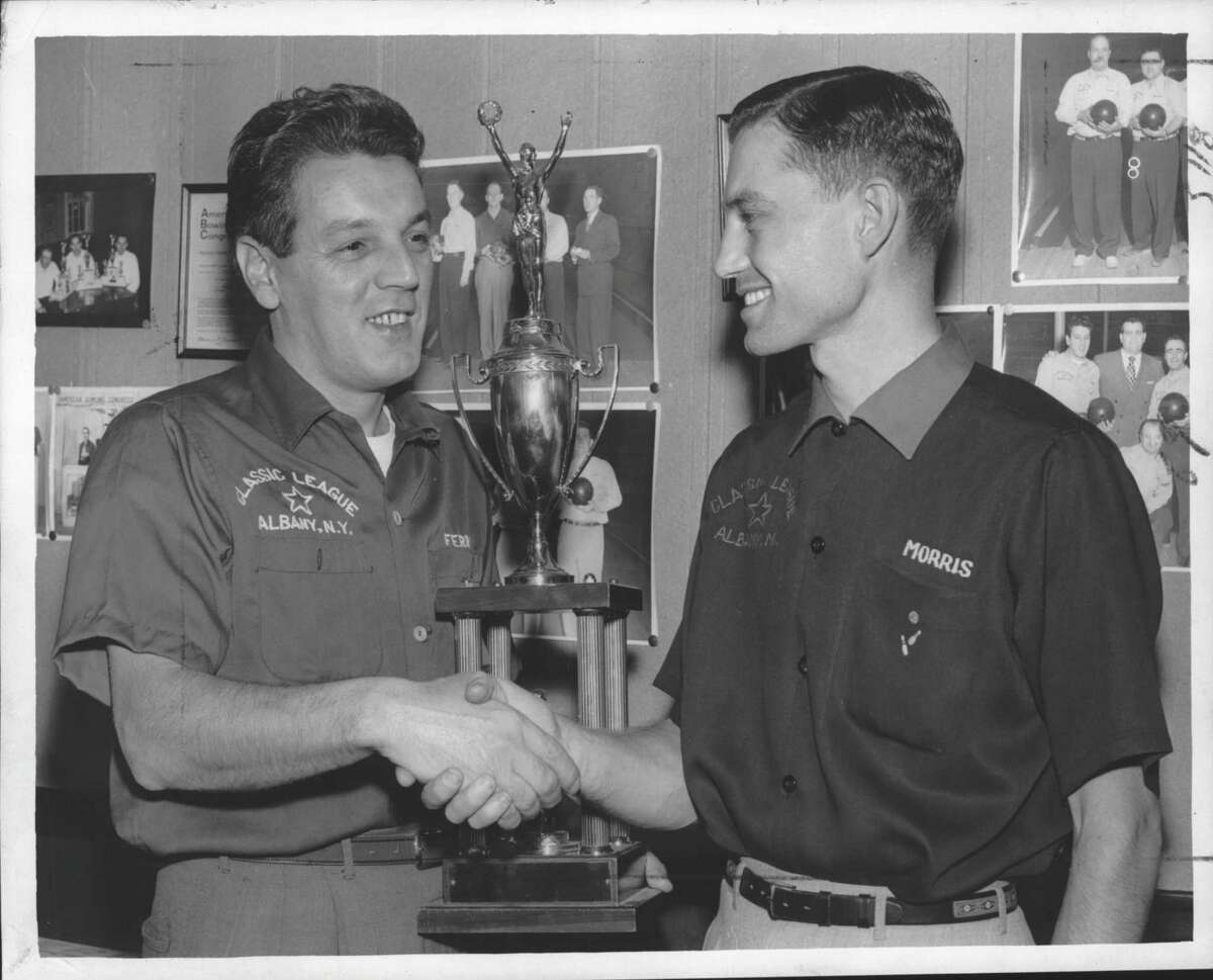 Frankie Ferris, left, congratulated by tournament director Morris Cramer. Photo is believed to be from 1960. .(Joe Higgins/Times Union Archive)