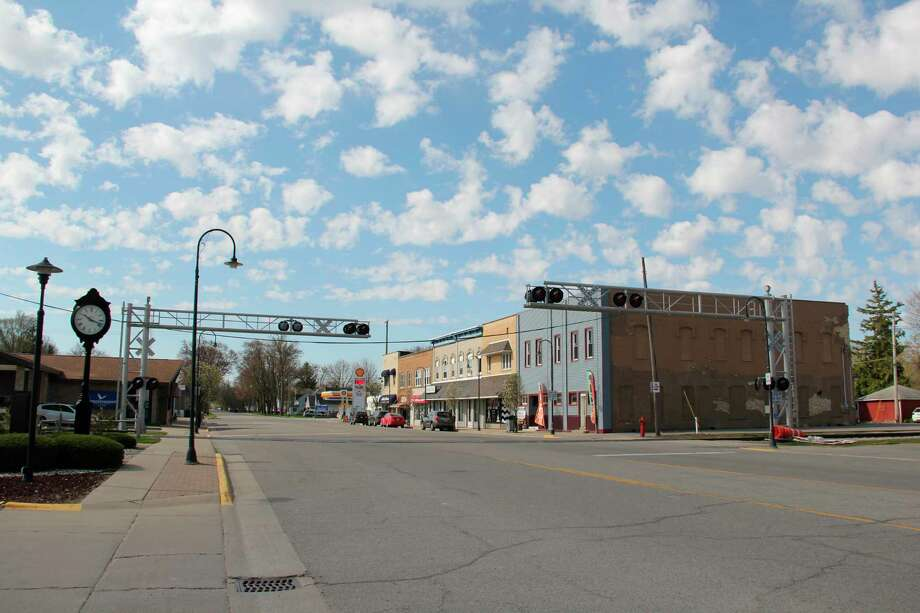 The railroad crossing along South Main Street in Pigeon. Work on the railroad line next week will cause traffic to be re-routed. (Robert Creenan/Huron Daily Tribune)