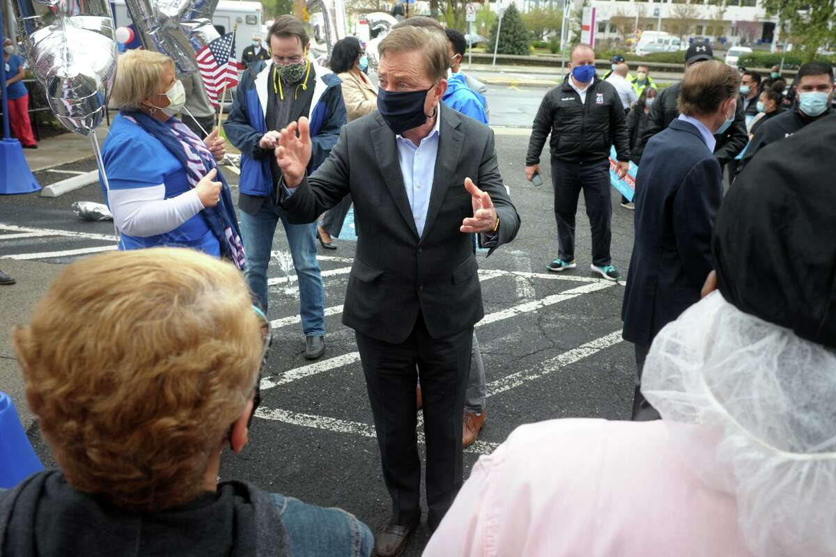 Gov. Ned Lamont speaks during a thankyou rally in front of Northbridge Health Care Center in Bridgeport, Conn. May 1, 2020. Several elected officials stopped at Northbridge Friday to thank the staff, where dozens of COVID-19 patients have been sent for recovery.