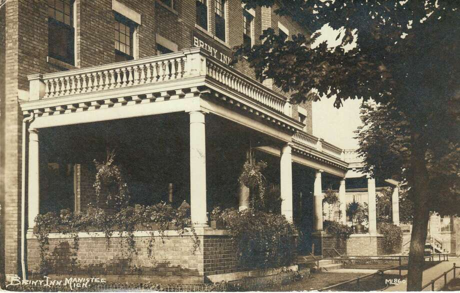 The porch of the Briny Inn was decorated with many summer plants in this early 1900 photograph.