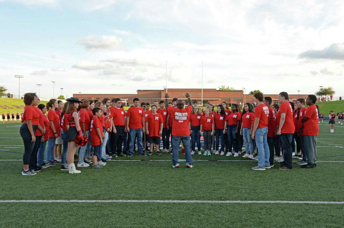 Tully Stadium, traditionally the home for sporting events in Spring Branch ISD, is scheduled to host the district's high school graduations beginning June 1, 2020. Shown here, the Memorial Choir performs the National Anthem before a high school football game between the Seven Lakes Spartans and the Memorial Mustangs on Thursday, Aug. 30, 2018.