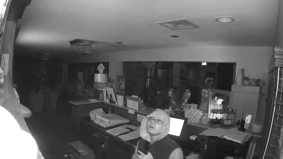 With the community's help, Danbury police say they have identified these men captured on camera during a burglary at the Ridgewood Country Club on May 3. Photo: Contributed Photo/Danbury Police Facebook Page / Contributed / The News-Times Contributed
