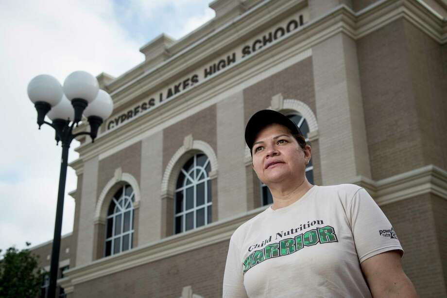 Gladys Navarro, the nutrition services general manager at Cypress Lakes High School in Cy-Fair ISD, has throughout the shutdown come to the school to help provide hundreds of students with curbside meals. Amid the pandemic, Navarro and a rotating cast of six employees spend each weekday packaging and delivering between 700 and 1,000 meals. Photo: Brett Coomer, Houston Chronicle / Staff Photographer / © 2020 Houston Chronicle