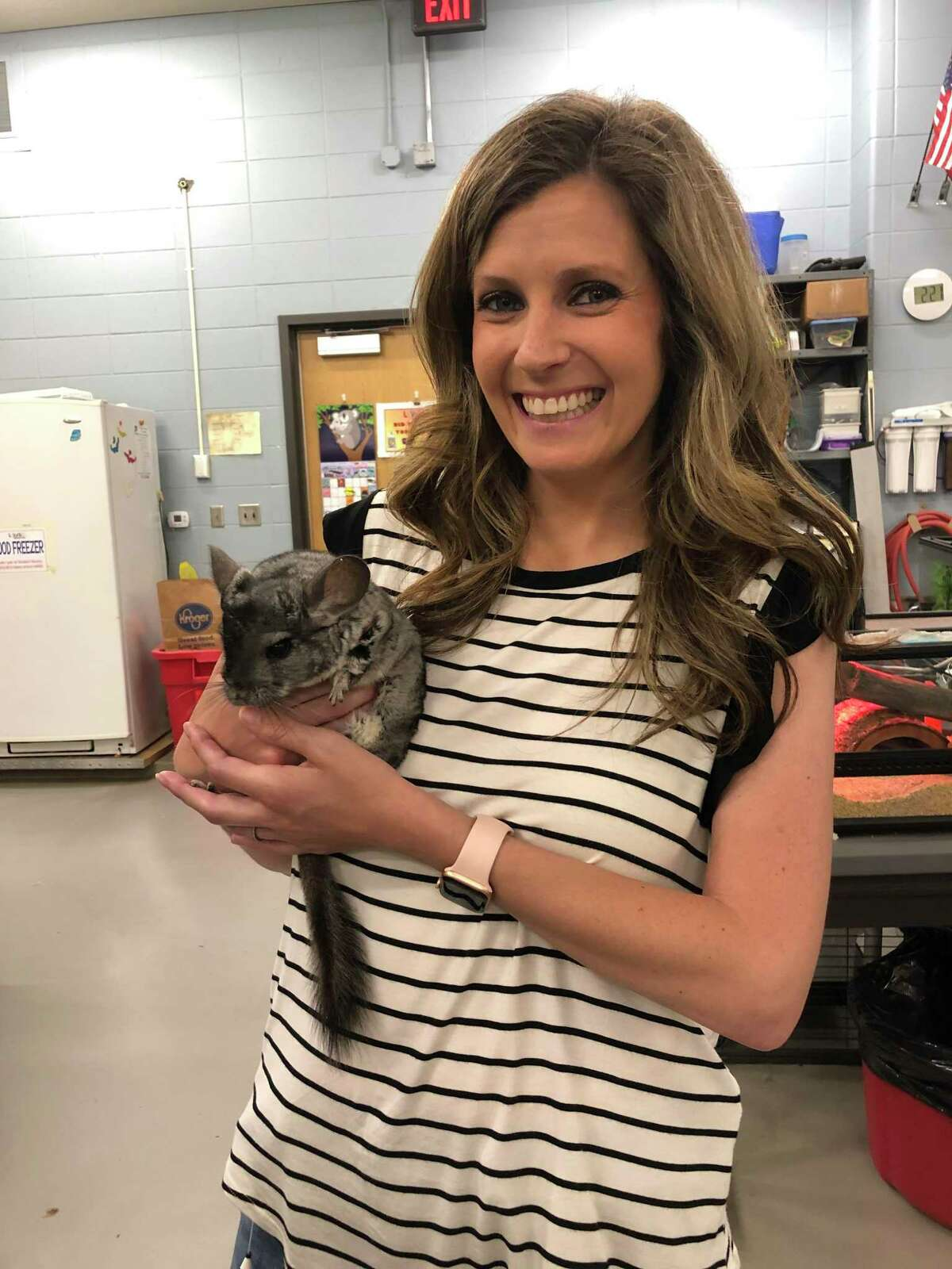 Nicole Hicks is the new principal of Seabrook Intermediate School, which she attended as a student. her friend is a chinchilla that is part of the school's Living Materials Center, which houses animals used in Clear Creek ISD classrooms and curriculum.