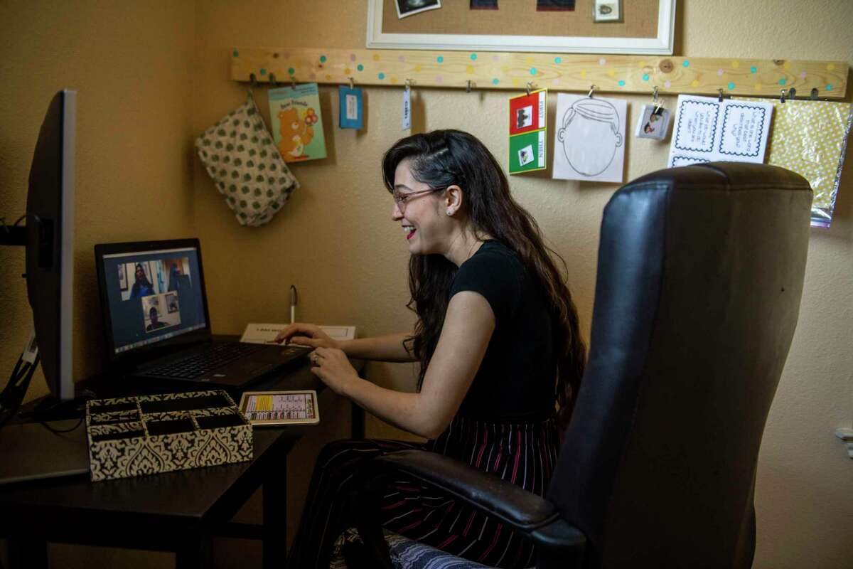 Behavior therapist Katelina Encerrando leads a behavioral telehealth session from her home for Cristian Martinez, 16, as board-certified behavior analyst Chelsea Centeno listens. San Antonio providers are increasingly leaning on telemedicine during the stay-at-home orders and coronavirus pandemic.