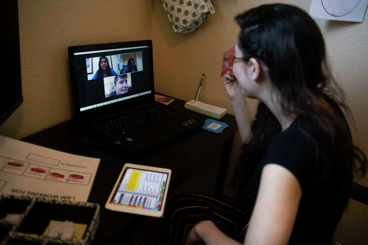 Autism Therapy Center behavioral therapist Katelina Encerrando leads a behavioral telehealth session from her home for Cristian Martinez, 16, as board-certified Behavior Analyst Chelsea Centeno watches on May 1.