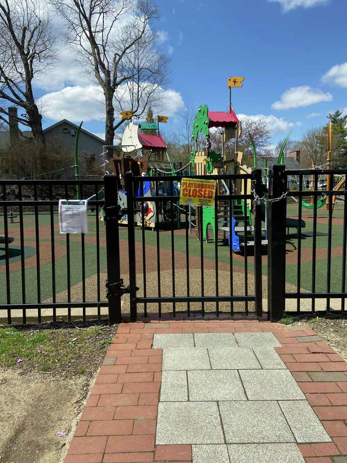 "A ""Playground Closed"" warns away parents and kids. All RIdgefield playgrounds, tennis and basketball courts, and playing fields have been closed since early in the coronavirus lock-down. Photo: Tracy Seem"