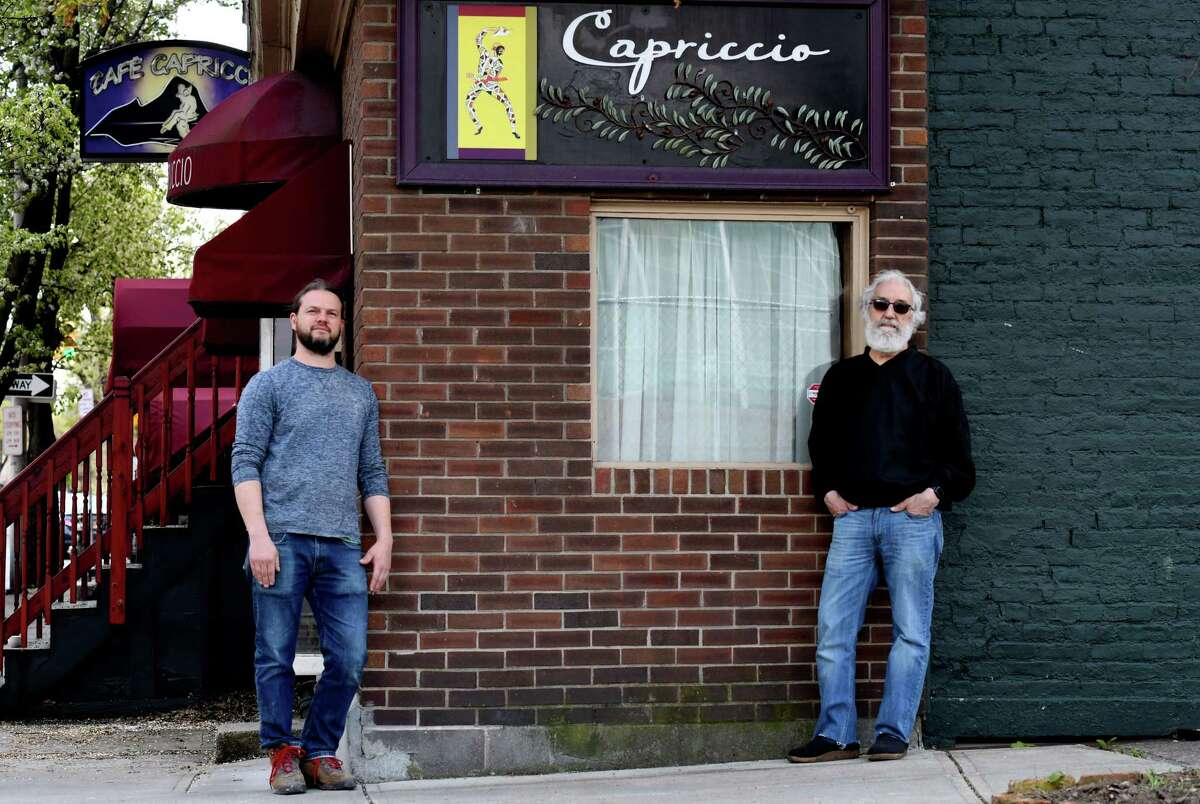 Cafe Capriccio co-owners Jim Rua, right, and his son, Franco, left, stand in front of where they plan add a new market to the storied Italian eatery on Thursday, May, 7, 2020, in Albany, N.Y. (Will Waldron/Times Union)