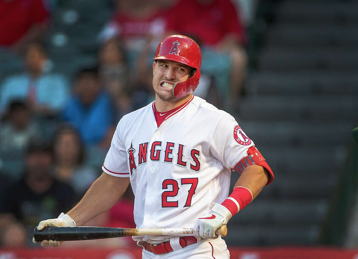 Mike Trout (pictured) and Clayton Kershaw objected to separating from their loved ones for prolonged stretches. So remaining in the Los Angeles area for another round of spring training and playing the regular season in familiar settings, while following local virus-combating procedures, would be palatable to them. The basics of the plan, as reported by USA Today: Players would have access to most of the spoils of a regular season without sacrificing proximity to family. Teams would play only within three geographically friendly divisions during the regular season, limiting travel to one region of the country. The format would change in the postseason. The number of people admitted into baseball's work environments would be limited, and all would be screened for COVID-19 symptoms regularly.