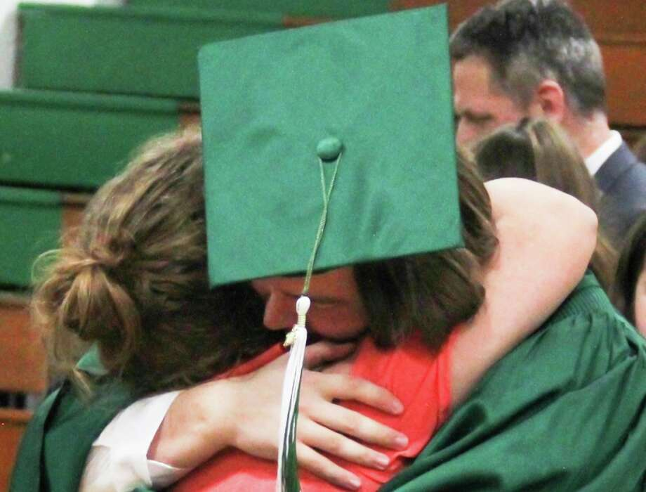 A member of Laker High School's Class of 209 hugs a loved one during the school's graduation ceremony. Laker has a number of special plans for its 2020 graduates. (Huron Daily Tribune, File)