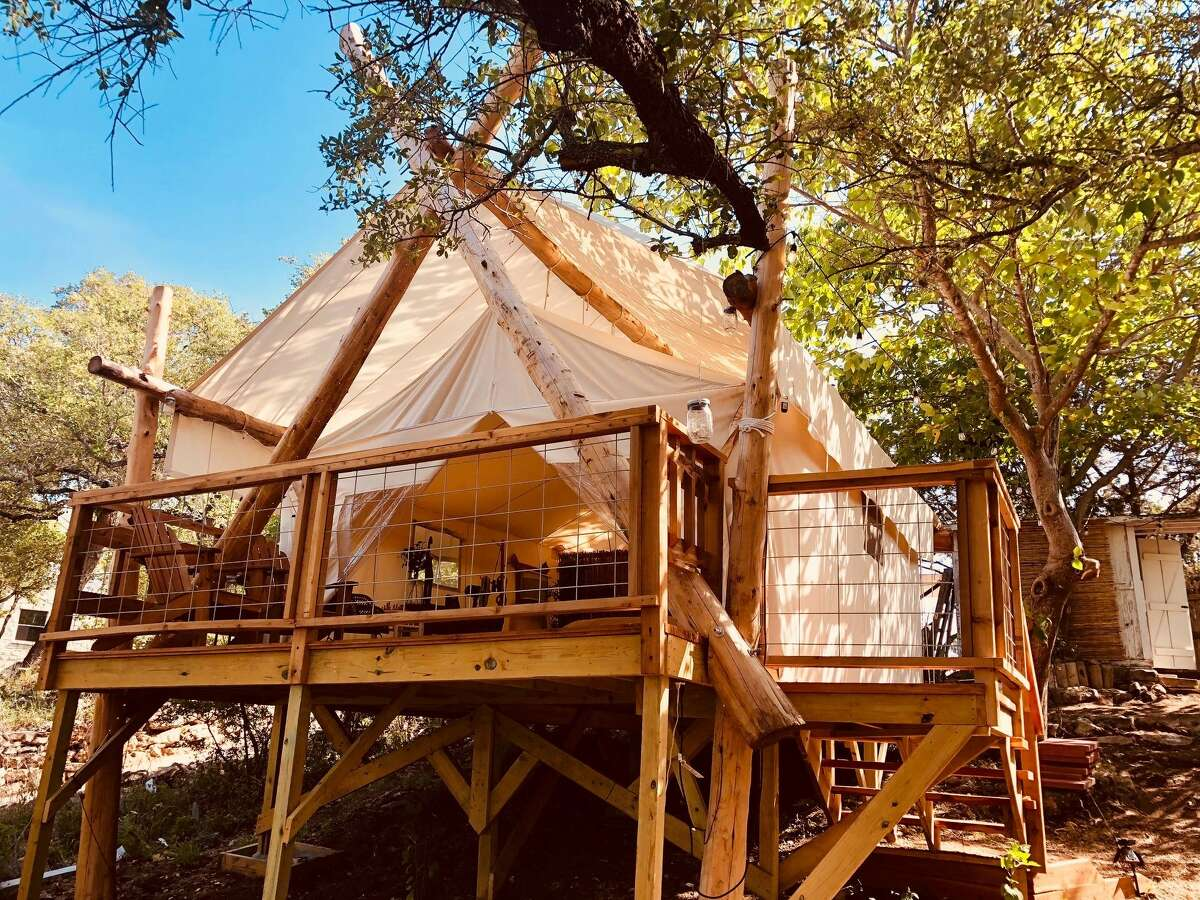 Living Waters on Lake Travis has a few options for lodging, from tents to bungalows to cabins. All come with beds and Wi-Fi if you're looking for a