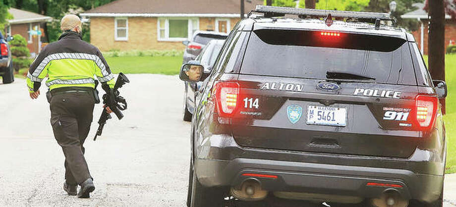 Alton Police were taking no chances Tuesday as they searched for the fleeing home invasion suspect, at first unsure which direction he had ran, from the Porter Street house where the alleged home invasion took place. Photo: John Badman | The Telegraph