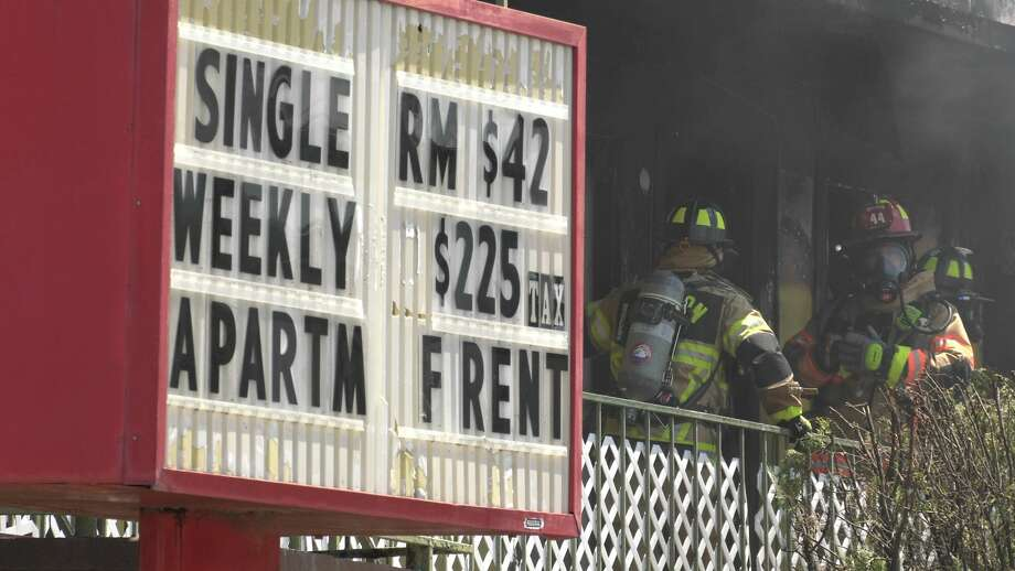 Houston firefighters put out a fire at the Normandy Inn along the East Freeway at Normandy Street on Thursday, May 7, 2020. Photo: Jay R. Jordan / Houston Chronicle