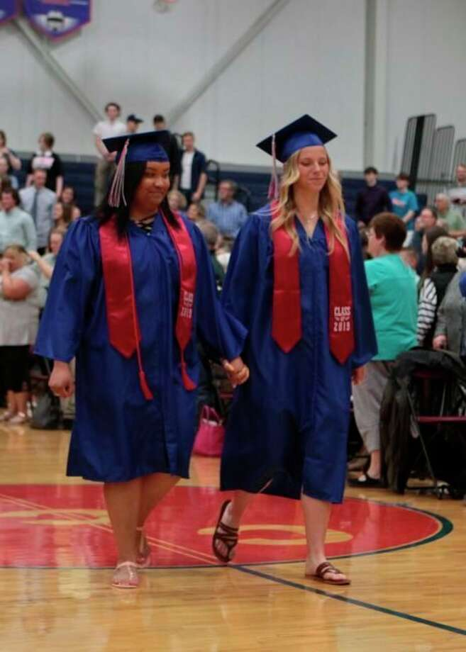 In this file photo, Crossroads Charter Academy seniors from the Class of 2019 make their way into the gymnasium for their graduation ceremony. CCA is hoping to have a similar ceremony this year for the class of 2020. (Pioneer file photo)
