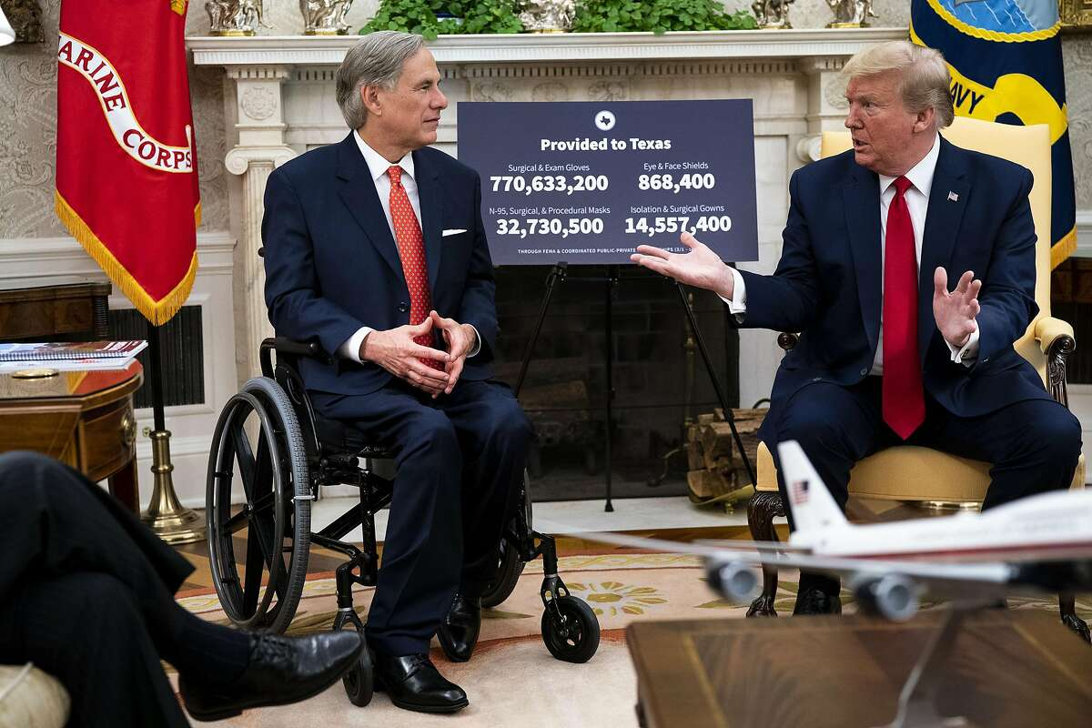 President Donald Trump meets with Republican Texas Gov. Greg Abbott in the Oval Office of the White House in Washington, Thursday, May 7, 2020. (Doug Mills/The New York Times)