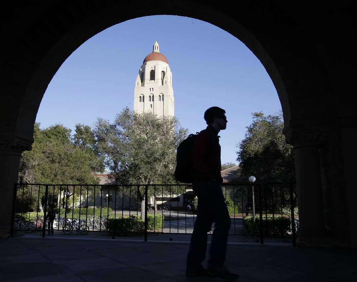 A Stanford University student walks in front of Hoover Tower on the campus in Palo Alto.