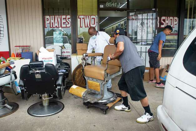 """""""I'd rather people be safe. It's not about the money,"""" said Joseph Hayes (left), manager of Phayes Two Barber Shop on W. Bellfort at S. Gessner, as he pulls everything out of the shop to continue a deep clean before their planned reopening Friday morning, while working on the shop on Thursday, May 7, 2020, in Houston. Hayes and manager Quincy Floyd (right) have been cleaning the shop for a week after learning that they would be able to reopen. Patrons will be expected to wear a mask, they will only take appointments, chairs will be at least six feet apart and no more than 10 people will be allowed inside at any time. Photo: Mark Mulligan, Staff Photographer / © 2020 Mark Mulligan / Houston Chronicle"""
