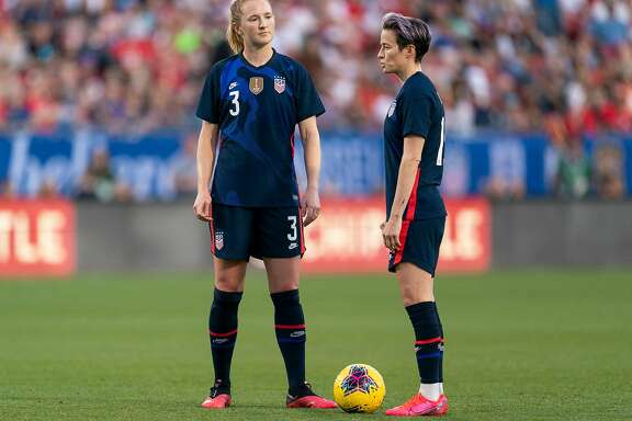 FRISCO, TX - MARCH 11: Sam Mewis #3 and Megan Rapinoe #15 of the United States talk during a game between Japan and USWNT at Toyota Stadium on March 11, 2020 in Frisco, Texas. ~~