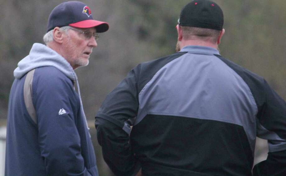 Big Rapids coach Sam Daugherty (left) talks with former Reed City coach Marty Shaffer during the 2019 season. (Pioneer file photo)