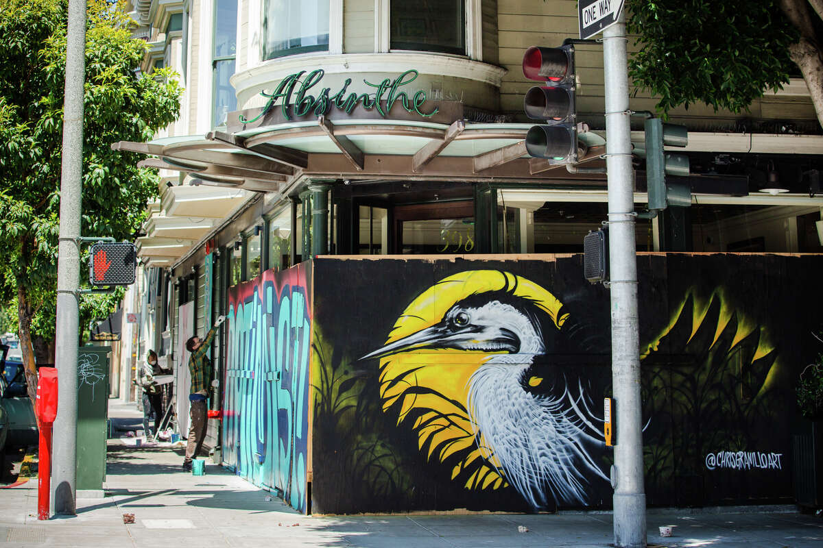 Among the artwork that has popped up around the city, you'll find Chris Granillo's striking heron set against a full moon (pictured above) covering Absinthe Restaurant in Hayes Valley. Granillo is a working artist in the Bay Area with roots in Mexico.