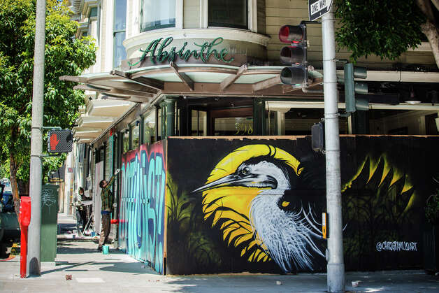 "Among the artwork that has popped up around the city, you'll find Chris Granillo's striking heron set against a full moon (pictured above) covering Absinthe Restaurant in Hayes Valley. Granillo is a working artist in the Bay Area with roots in Mexico.""He applied and was recommended by other muralists, and it was like overnight that his mural went up and it was amazing. It has been amazing to see just how quickly all this artwork has appeared all over the city."" Photo: Courtesy Of Lisa Vortman :: Artist: Chris Granillo"