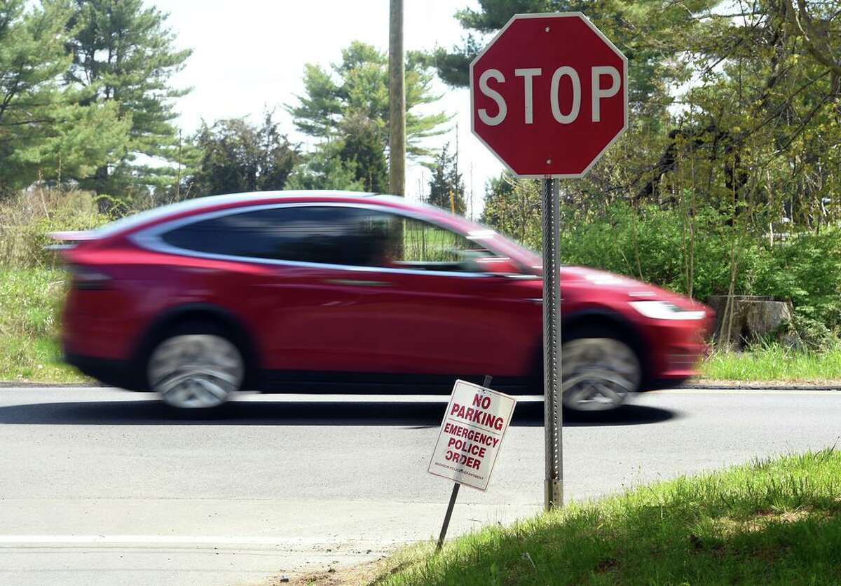 """In this file photo, the """"No Parking - Emergency Police Order"""" on Signal Hill Road near the entrance to Hammonasset Beach State Park in Madison on May 7, 2020. The state will keep its campgrounds at the park and elsewhere closed until at least June 11."""