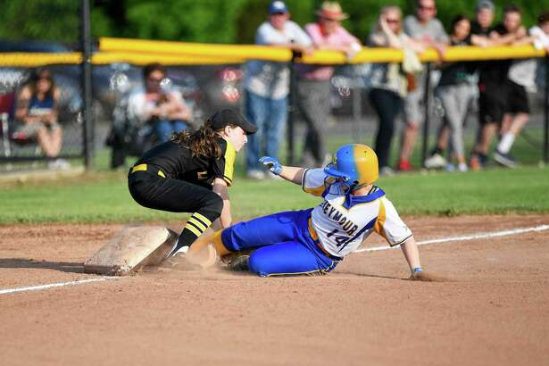 Seymour's Erin Lifrieri slides in ahead of Law's Grace Kantor's tag during the Class M quarterfinals in 2019.