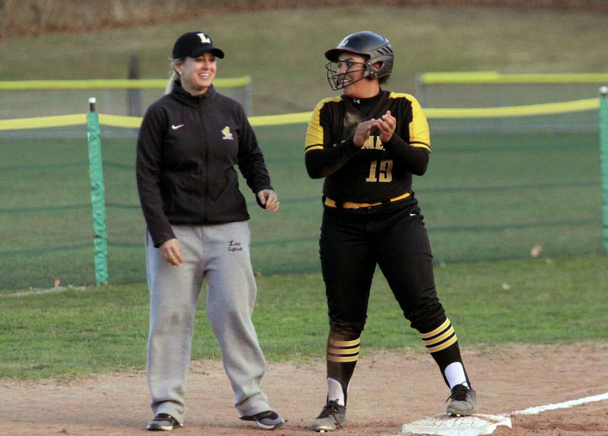 Law softball coach Melanie Blude, left, during a game against Mercy in 2019.
