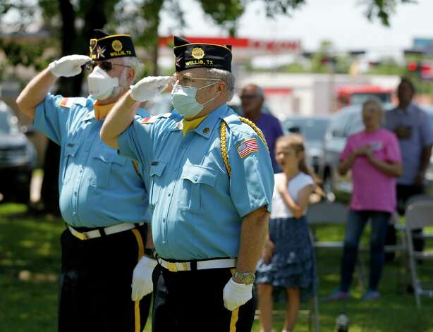 American Legion honor guard members Jack Clemons, left, and Ralph Massengill salute the American flag while wearing facemasks during a National Day of Prayer, Wednesday, May 6, 2020, in Willis. Photo: Jason Fochtman, Staff Photographer / 2020 © Houston Chronicle