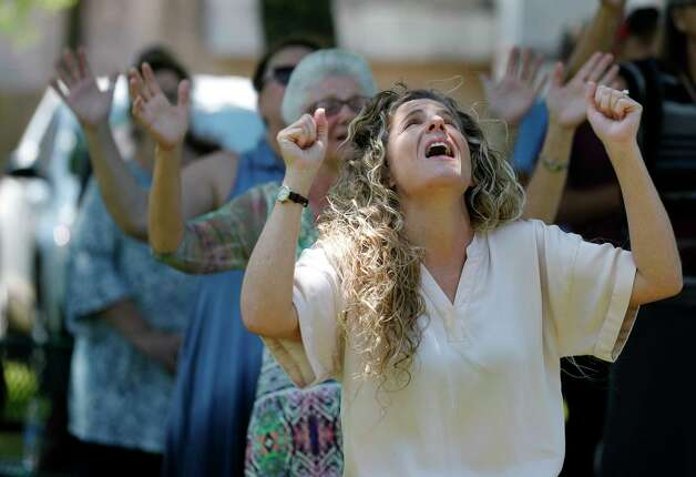Laure Harrell worships during a National Day of Prayer, Wednesday, May 6, 2020, in Willis. Photo: Jason Fochtman, Staff Photographer / 2020 © Houston Chronicle