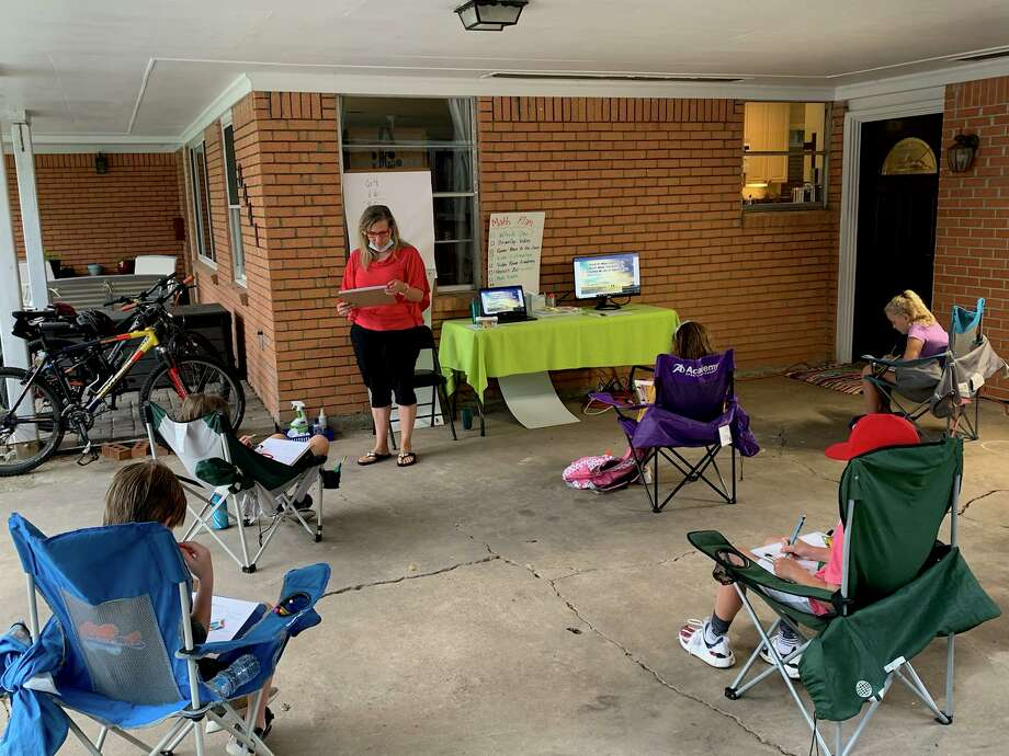 Spring Branch ISD teacher Krista Dina hosts a carport classroom every Tuesday for third graders at Valley Oak Elementary.