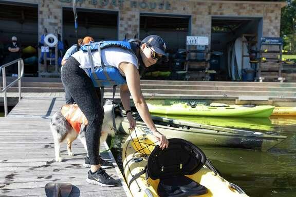 Senia Urrea prepares to hop into a row boat at the Riva Row Boat House.