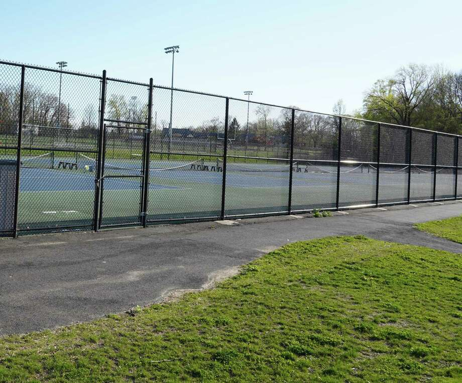 The tennis courts at New Canaan High School are open again daily from 8 a.m. to 7 p.m. for the town's residents. The high school's track has also re-opened. The courts, and the track re-opened on Sunday, a day later amid the coronavirus pandemic because of the weather on Saturday. Photo: Grace Duffield / Hearst Connecticut Media