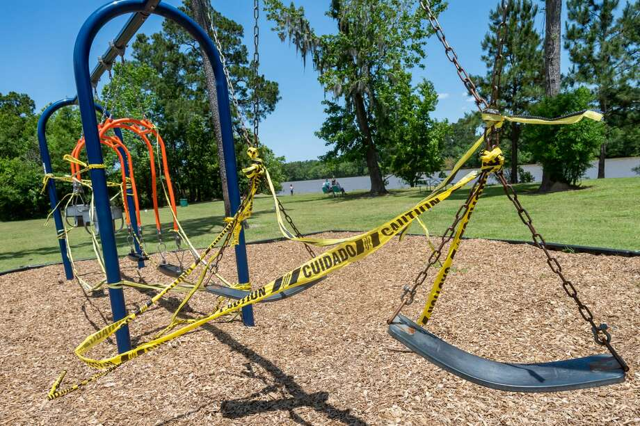 Caution tape encircles swings at Collier's Ferry Park on Pine Street in Beaumont. Fran Ruchalski/The Enterprise Photo: Fran Ruchalski/The Enterprise / © 2020 The Beaumont Enterprise