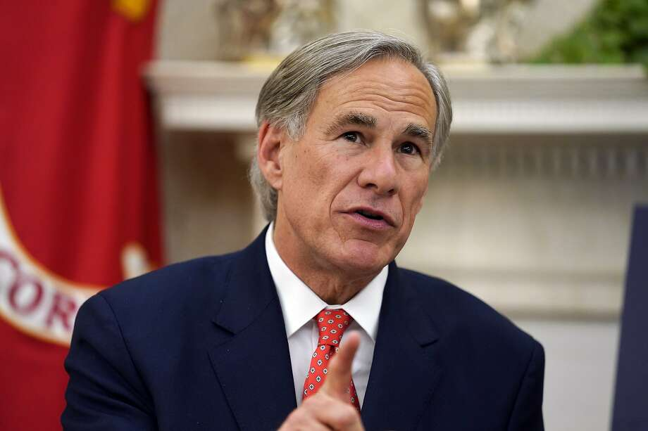 Texas Gov. Greg Abbott speaks with President Donald Trump during a meeting about the coronavirus response in the Oval Office of the White House, Thursday, May 7, 2020, in Washington. (AP Photo/Evan Vucci) Photo: Evan Vucci, Associated Press