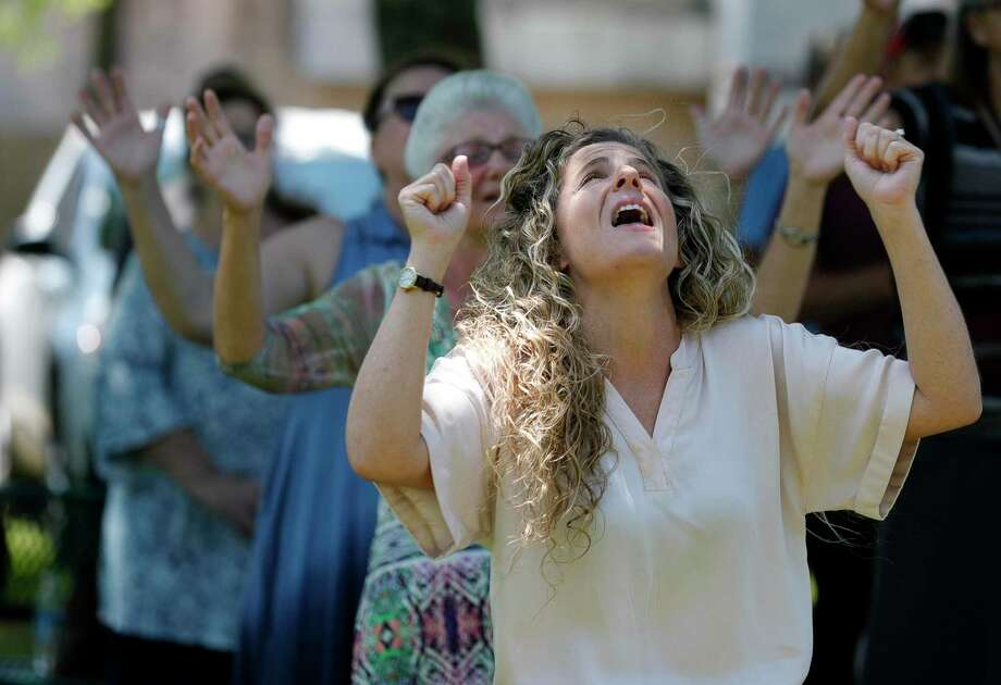 Laure Harrell worships during a National Day of Prayer, Wednesday, May 6, 2020, in Willis. Photo: Jason Fochtman, Houston Chronicle / Staff Photographer / 2020 © Houston Chronicle