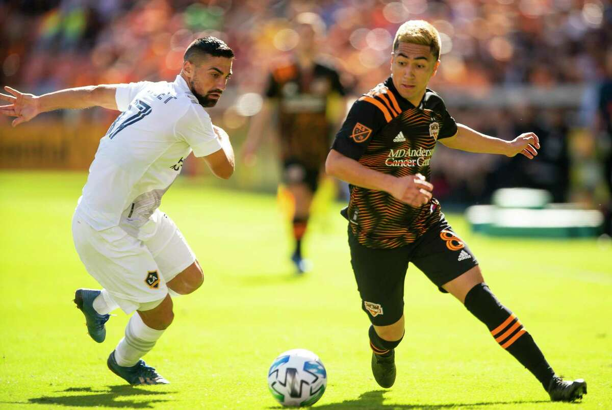 Houston Dynamo midfielder Memo Rodriguez, in action against the Galaxy in February, will return to competition in July in the MLS' new tournament in Orlando.