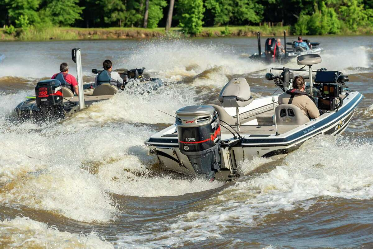 Once they clear the folks fishing on the shoreline, the anglers blast off down the river as the Neches River Bass Association began their 2020 season on Thursday night with over 25 boats participating. Photo made on May 7, 2020. Fran Ruchalski/The Enterprise