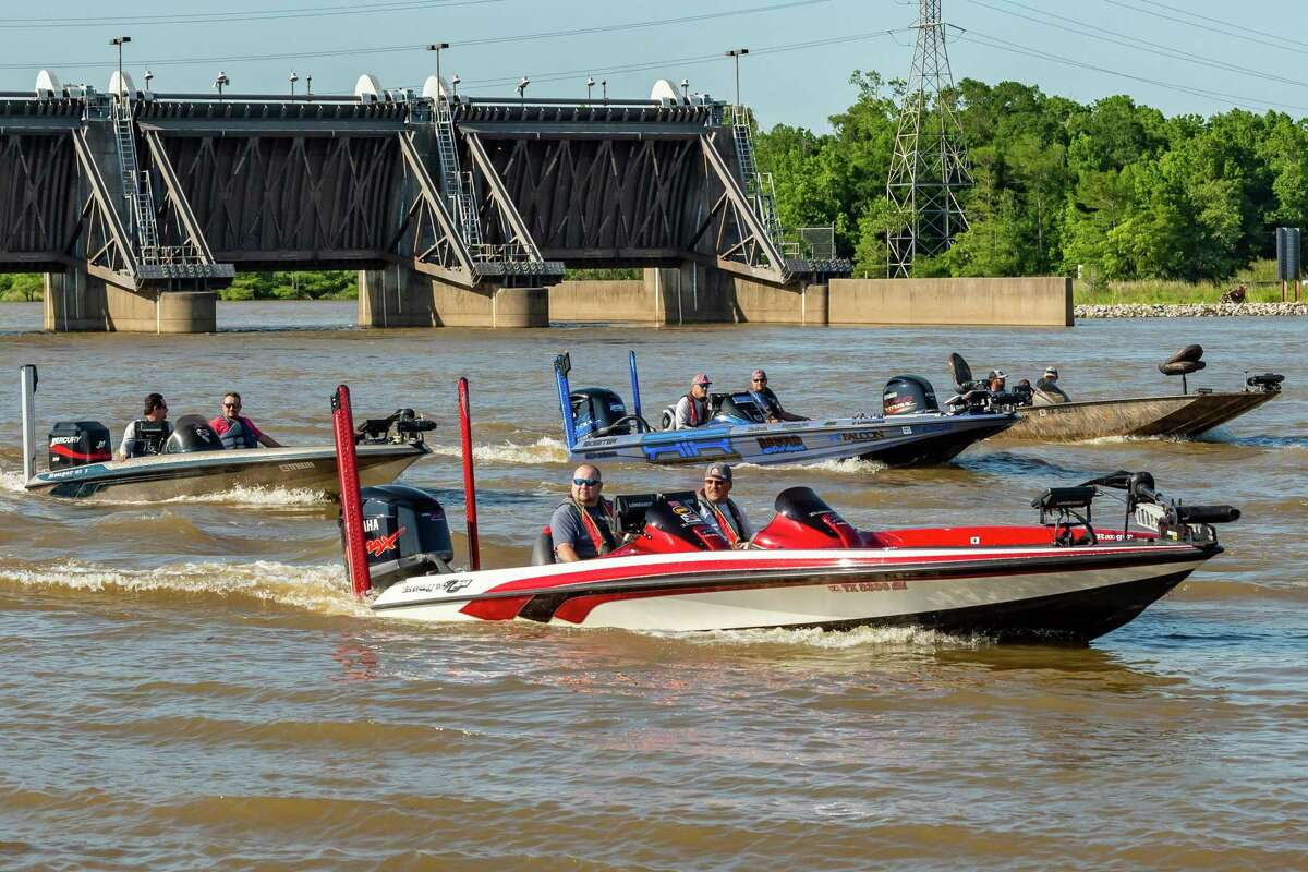 Anglers head out in their boats around the Neches River Salt Water Barrier to compete as the Neches River Bass Association began their 2020 season on Thursday night with over 25 boats participating. Photo made on May 7, 2020. Fran Ruchalski/The Enterprise