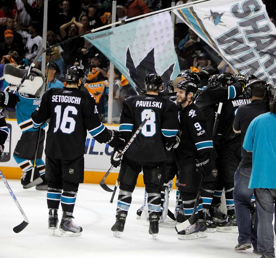 Sharks players celebrate at what was then called HP Pavilion after defeating Detroit 3-2 in Game 7 of the West semifinals. Photo: Carlos Avila Gonzalez / The Chronicle