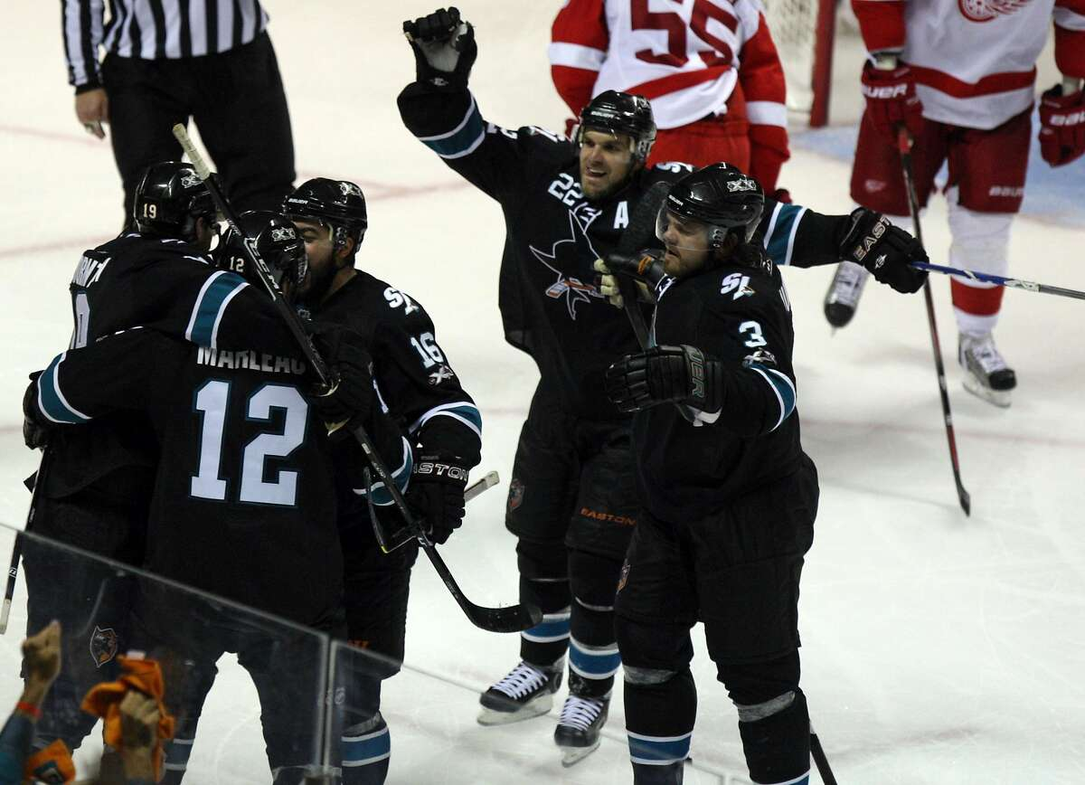 Jose Sharks Patrick Marleau (12) celebrates with his teamamtes after scoring the winning goal against the Detroit Red Wings in the third period of Game 7 of a second-round NHL Stanley Cup playoff hockey game in San Jose California, Thursday May 12, 2011. Sharks win 3-2 to take the series.