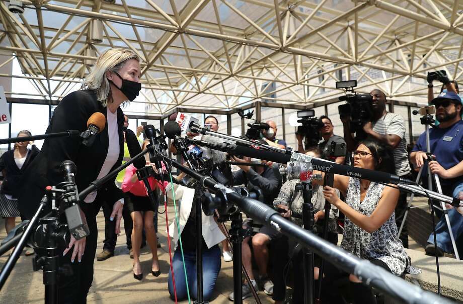 Salon owner Shelley Luther leans in to speak to the media after she was released from jail in Dallas, Thursday, May 7, 2020. Luther was jailed for refusing to keep her business closed amid concerns of the spread of COVID-19. (AP Photo/LM Otero) Photo: LM Otero, Associated Press
