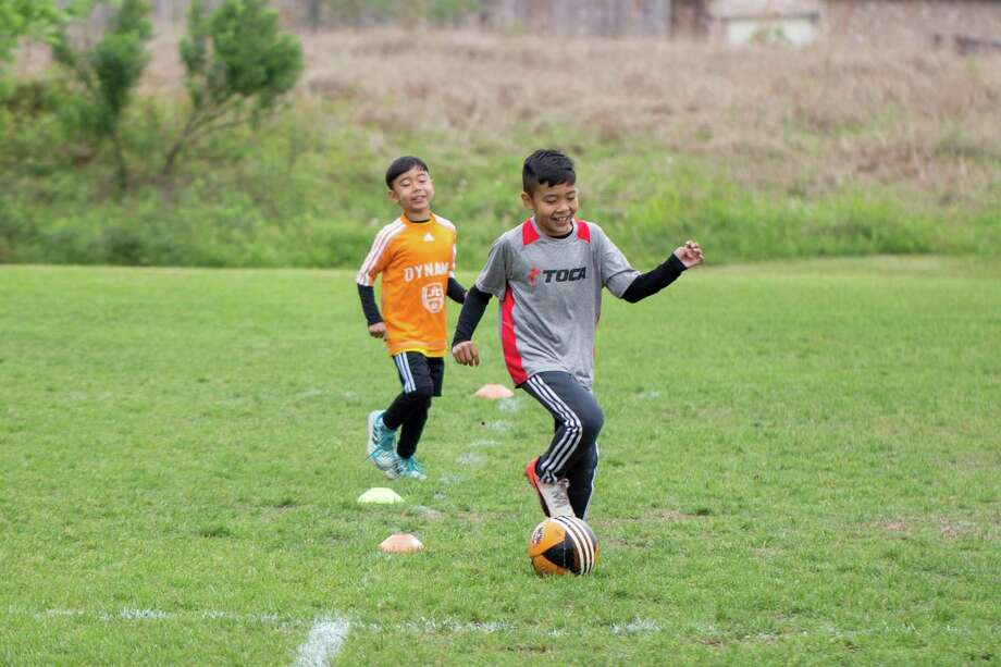 """Caleb Coronel, the 11-year-old son of the JC Sports owners Jennifer and Cesar, decided to use his time physically distancing to connect with professional soccer players around the world weekly and share their advice with his teammates, and anyone else interested in watching. While they are apart, the team is still able to advance their skills with individual training and listening to the experts through his video series, """"Ask the Pros."""" Photo: Courtesy Of CesarCoronel / Courtesy Of CesarCoronel"""