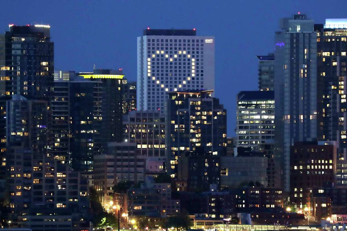 A giant heart created by windows lit by the building's engineering team is illuminated in the Hyatt Regency hotel as a way to lift the spirits of the community in the midst of the coronavirus outbreak, Thursday, May 7, 2020, in Seattle. The heart-shaped lighting began on the building in late March and has continued since.