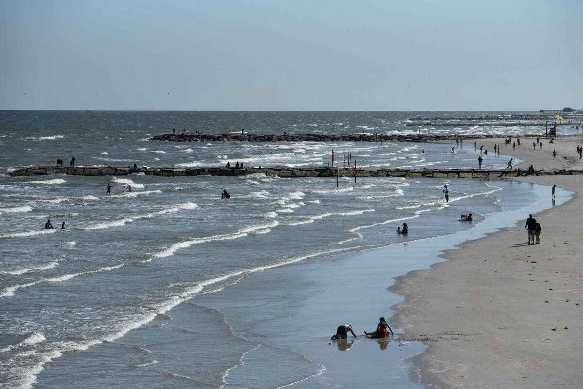 GALVESTON, TX - MAY 01: People sunbathe on the beach after it was reopened on May 1, 2020 in Galveston, Texas. As part of phase one Gov. Greg Abbott reopened the beaches to the public Friday along with restaurants and retailers. (Photo by Callaghan O'Hare/Getty Images)