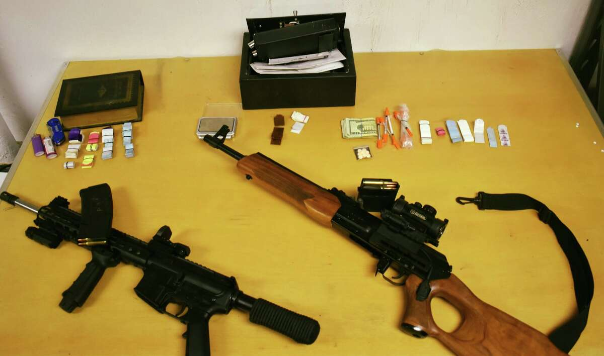 The two rifles and drugs that Gloversville Police say they recovered after a reported robbery on Thursday.